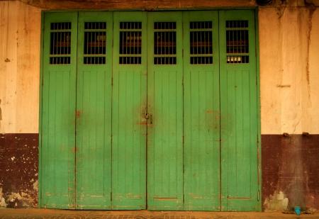 krung: the old green door at Charoen Krung Rd.near golden mountain in the bangkok