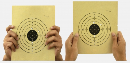 pratice: paper target for shooting pratice with grabing hands on the white background