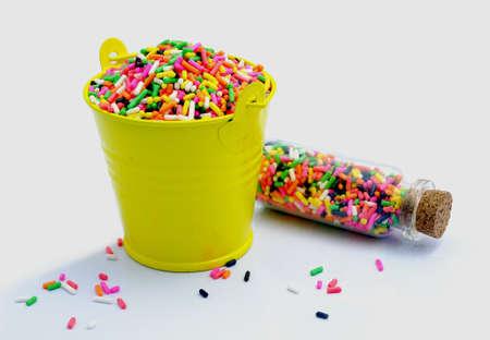 glaze: sprinkles in a bucket .donut glaze; on white background