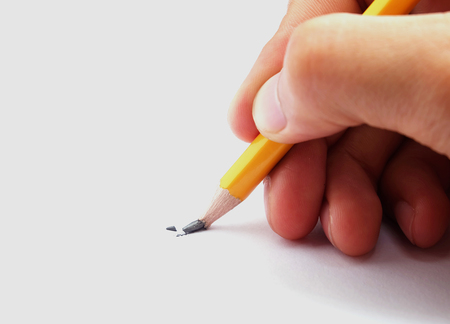 man holding the broken pencil on white background