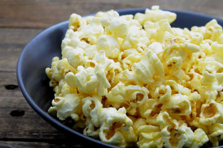 buttered: buttered popcorn on the back bowl Stock Photo