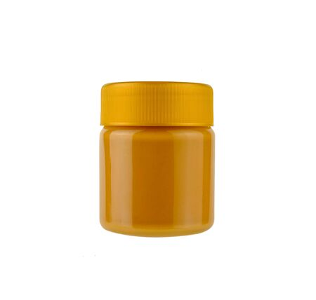 peanut butter in glass bottle on white background