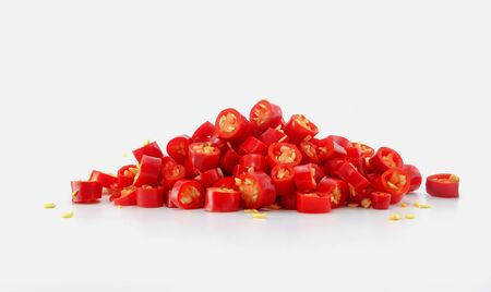 pile of slice red chili on white background