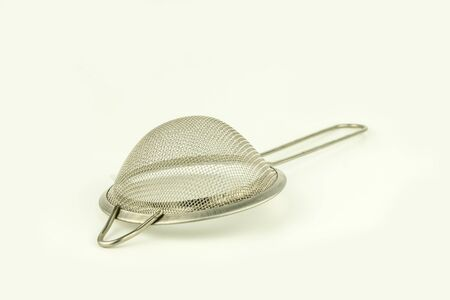 handle stainless sieve on white background