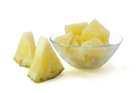 slice pineapple for eating in glass bowl on white background