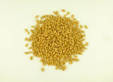 top view of wheat grain on white background