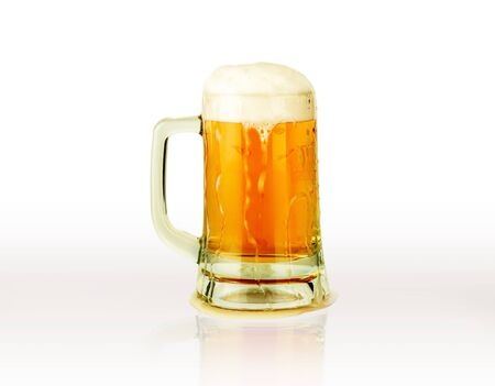 beer mug with beautiful foam falling on white background