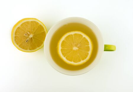 fresh lemon juice squeeze on cup on white background