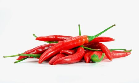 pile of red chili on white background