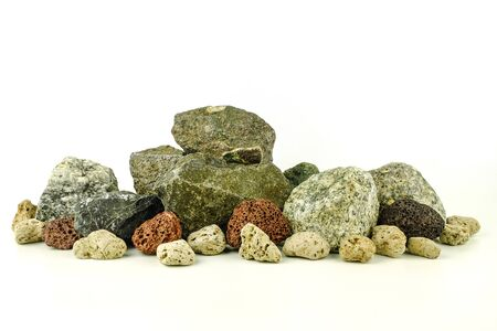 different kind of pebbles stones on white background
