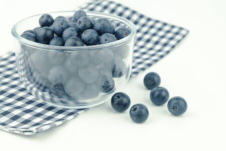 fresh blueberry in glass bowl on white background Stock Photo