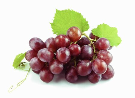fresh red grape with leaves on white background Stock Photo