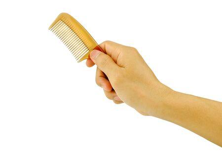 a hand holding hairbrush Stock Photo