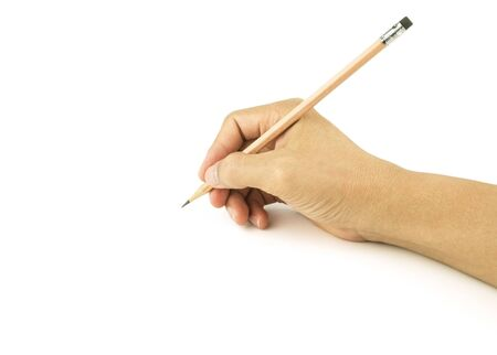 holding wooden pencil writing on white background Stock Photo - 134864434