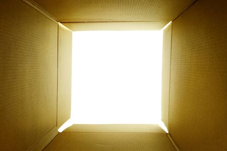 open empty carton box with light ray use forpeople looking inside