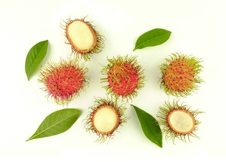 opened rambutan fruit and leaves on white background