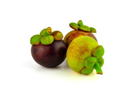 ripe and raw mangosteen with on white background Stock Photo - 134864549