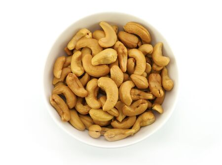 top view cashews nut in white bowl on white background