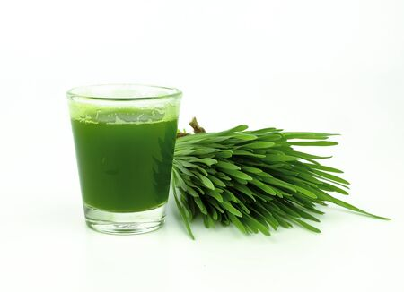 wheat grass juice for detox on white background Stock Photo - 134864611
