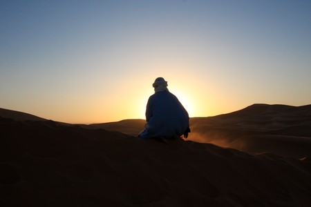 berber: Berber Man at Sunset in the Sahara Stock Photo