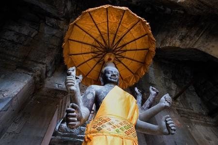 angkor: Angkor Wat statue with unbrella
