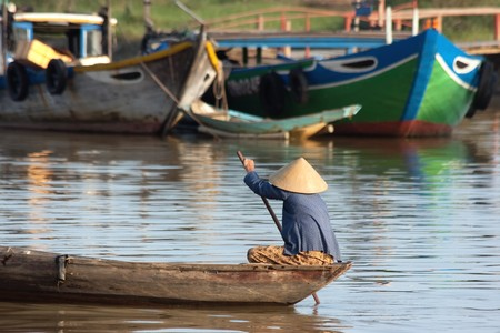 Hoi An boat driver with traditional hat photo