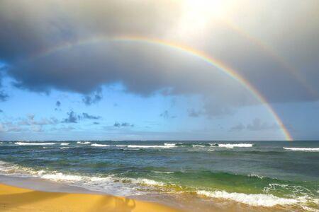 Double rainbow over the Pacific Ocean near the Aston Islander on the Beach hotel, Kapaa, Kauai, Hawaii, USA