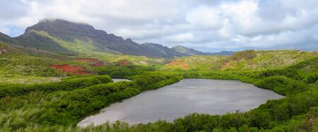 Panoramic view of Menehune fish pond aka Alekoko Fishpond on a bright summer day, near the mountains, near Lihue, Kauai, Hawaii, United States