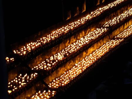 Burning candles in monastery, Tibet, China Imagens - 129627856
