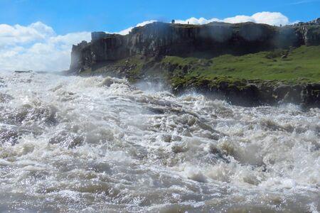 White water from the Jokulsa a Fjollum river splashing on camera lens at Dettifoss, Iceland, Europe