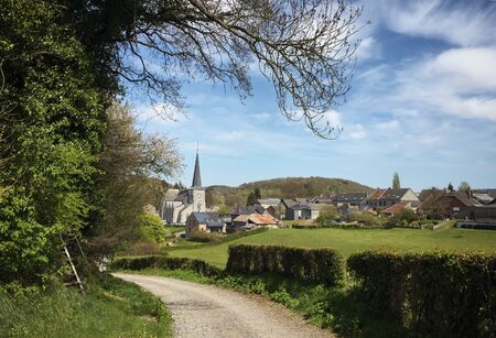 Small road leading to the rural village of Limbourg, typical Belgian countryside, Belgium, Europe