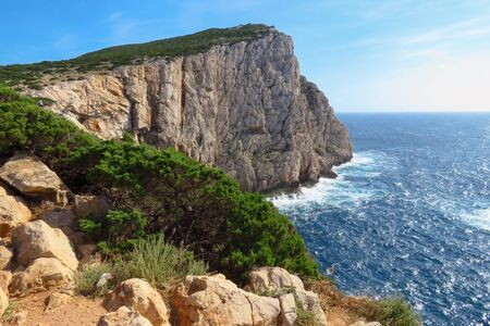 Rugged coastline and steep vertical cliffs, Mediterranean sea,  Capo Caccia, Sardinia, Italy, Europe