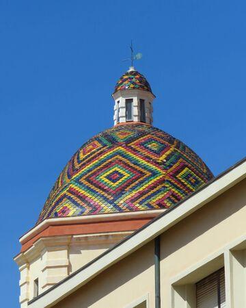 Colourful dome of the church of San Michele in Alghero, Sardinia, Italy Banco de Imagens