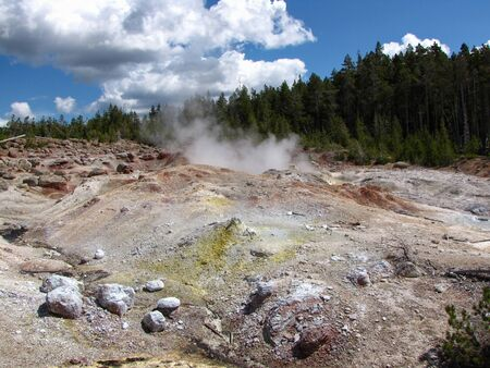 Colorful sediment and steam rising up from hot spring Stock fotó