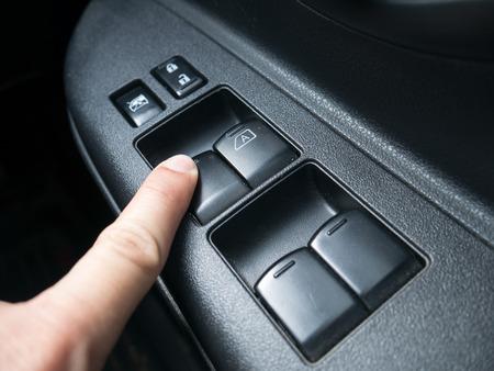 open car door: press the button to open car door Stock Photo
