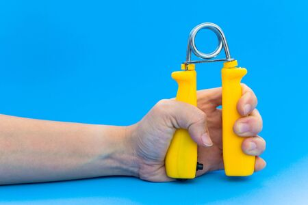 clench: spring hand grip for exercise Stock Photo