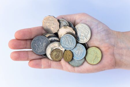 International money coins in the palm photo