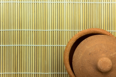 bamboo mat: Opened clay pottery on bamboo mat Stock Photo