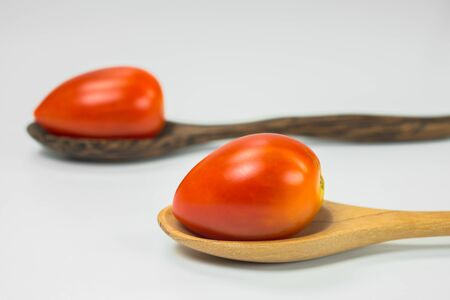 Fresh tomatoes in the spoons photo