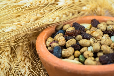 dried cereal seeds and fruits with stalks of wheat ears photo