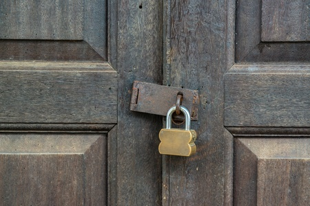 oxidize: Old padlock on a wooden door