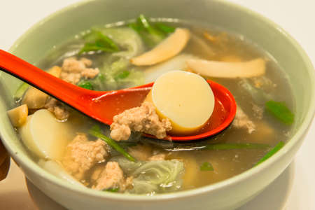 a bowl of Thai soup with fresh ingredients  photo