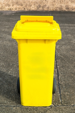 yellow recycling bin  photo