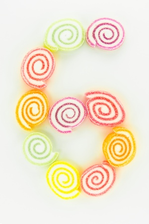 number 6 written with slices of dried sweet candies photo