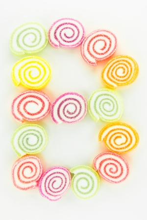Letter B written with slices of dried sweet candies photo