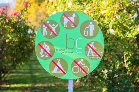 Sign on a park, with no littering, no ride bikes and no dogs photo