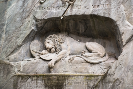 stone lion: Dying lion monument in Lucerne, Switzerland  Editorial