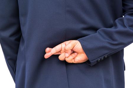 Zakenman in de rug met de vingers gekruist Stockfoto