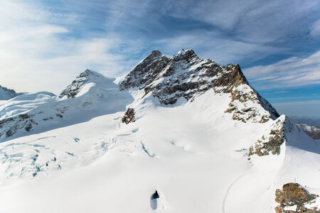 Jungfraujoch, Part of Swiss Alps Alpine Snow Mountain Landscape at Switzerland photo