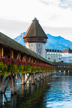 Panoramic view of wooden Chapel bridge and old town of Lucerne, Switzerland photo